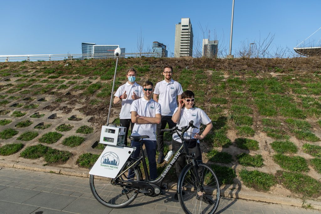 A group of people on a bicycle  Description automatically generated with medium confidence