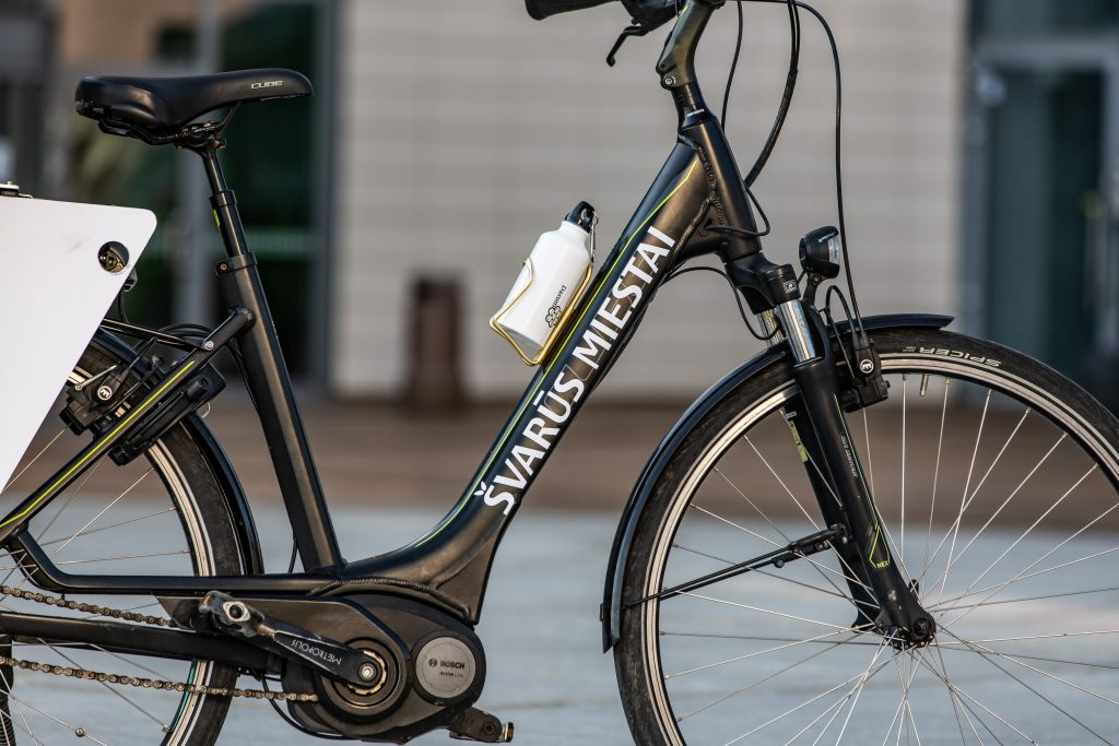 A picture containing bicycle, building, outdoor, transport  Description automatically generated